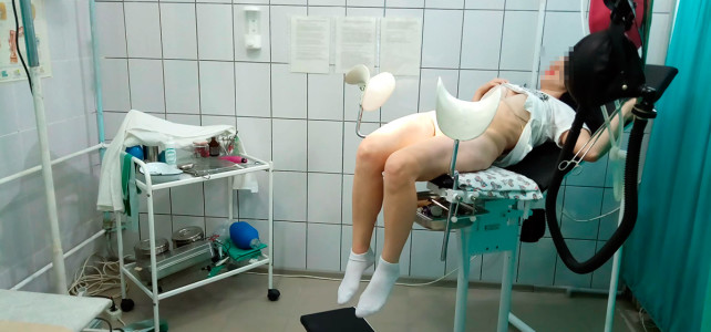 Forcible examination girl on a gynecological chair